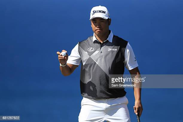 Hideki Matsuyama of Japan reacts on the tenth green during the final round of the SBS Tournament of Champions at the Plantation Course at Kapalua...