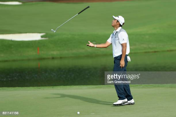 Hideki Matsuyama of Japan reacts to a missed putt on the 16th green during the final round of the 2017 PGA Championship at Quail Hollow Club on...