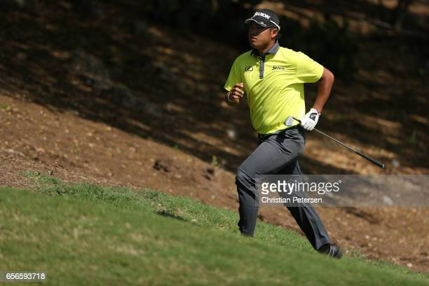 Hideki Matsuyama of Japan runs up the 18th hole of his match during round one of the World Golf ChampionshipsDell Technologies Match Play at the...