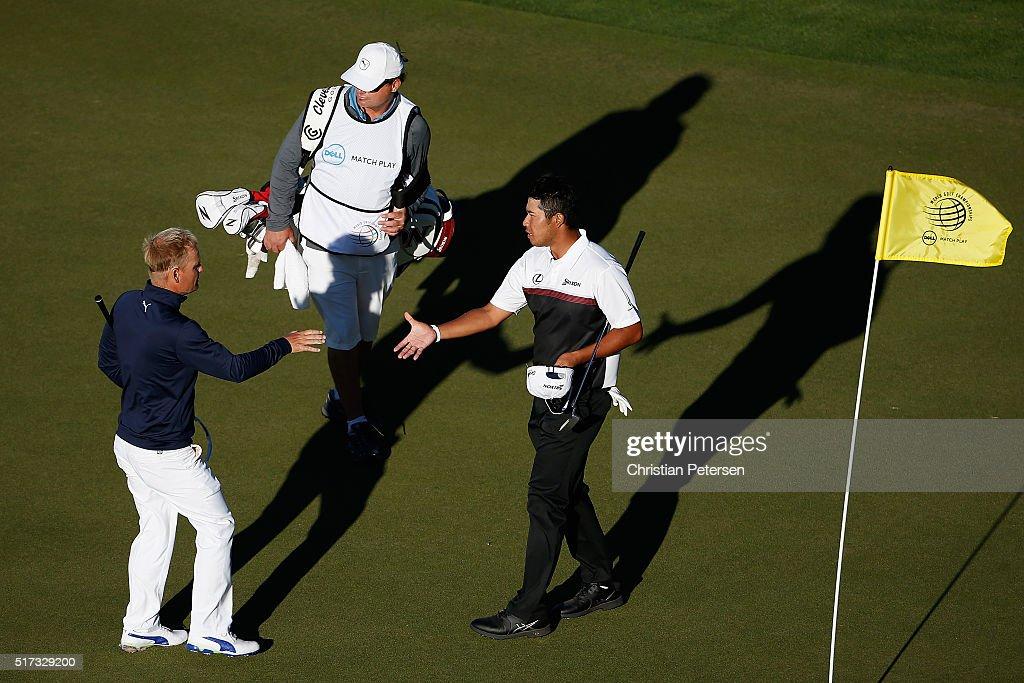 Hideki Matsuyama of Japan shakes hands with Soren Kjeldsen of Denmark on the 16th green after Matsuyama won their match 42 during the second round of...