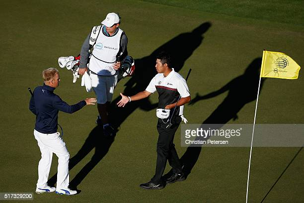 Hideki Matsuyama of Japan shakes hands with Soren Kjeldsen of Denmark on the 16th green after Matsuyama won their match 42 during the second round of...