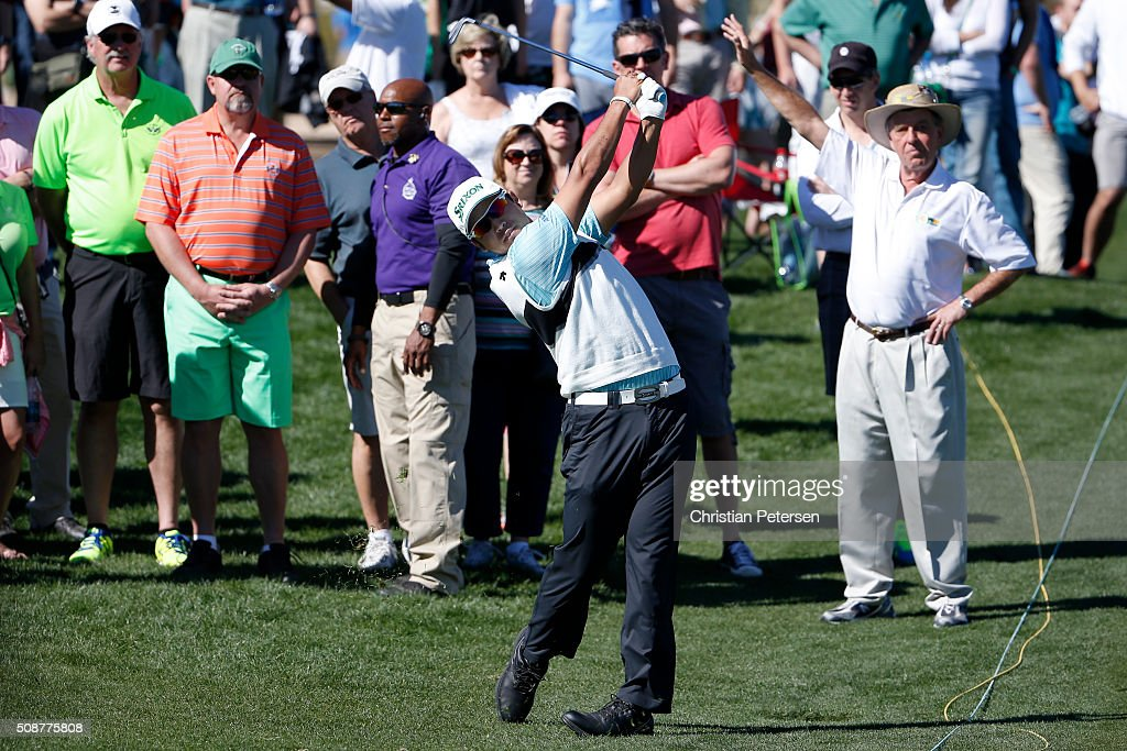 <a gi-track='captionPersonalityLinkClicked' href=/galleries/search?phrase=Hideki+Matsuyama&family=editorial&specificpeople=5566852 ng-click='$event.stopPropagation()'>Hideki Matsuyama</a> of Japan takes his second shot on the eighth hole during the third round of the Waste Management Phoenix Open at TPC Scottsdale on February 6, 2016 in Scottsdale, Arizona.