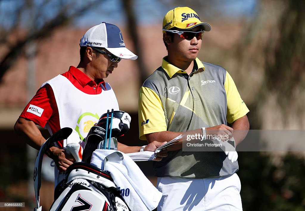 <a gi-track='captionPersonalityLinkClicked' href=/galleries/search?phrase=Hideki+Matsuyama&family=editorial&specificpeople=5566852 ng-click='$event.stopPropagation()'>Hideki Matsuyama</a> of Japan talks with his caddie Daisuke Shindo as he prepares to tee off on the second hole during the final round of the Waste Management Phoenix Open at TPC Scottsdale on February 7, 2016 in Scottsdale, Arizona.