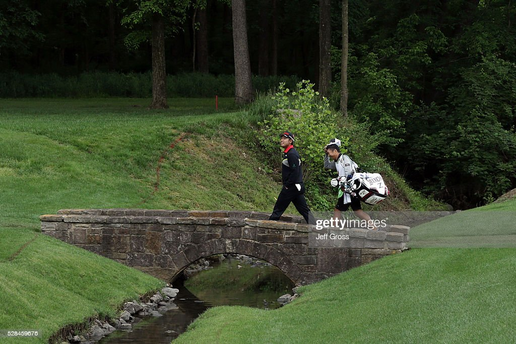 Hideki Matsuyama of Japan walks across a bridge on the 13th hole during the first round of the Wells Fargo Championship at Quail Hollow Club on May 5, 2016 in Charlotte, North Carolina.