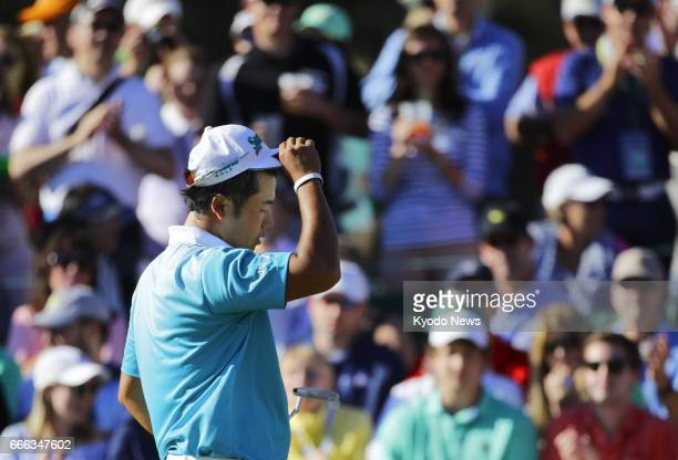 Hideki Matsuyama of Japan walks off the 18th green after making a double bogey during the third round of the Masters Tournament at Augusta National...