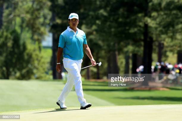 Hideki Matsuyama of Japan walks onto the firsts green during the third round of the 2017 Masters Tournament at Augusta National Golf Club on April 8...