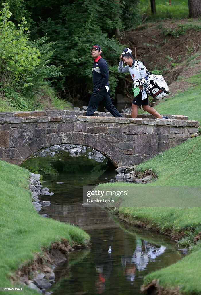 <a gi-track='captionPersonalityLinkClicked' href=/galleries/search?phrase=Hideki+Matsuyama&family=editorial&specificpeople=5566852 ng-click='$event.stopPropagation()'>Hideki Matsuyama</a> walks over the bridge on the 13th hole during the first round of the 2016 Wells Fargo Championship at Quail Hollow Club on May 5, 2016 in Charlotte, North Carolina.