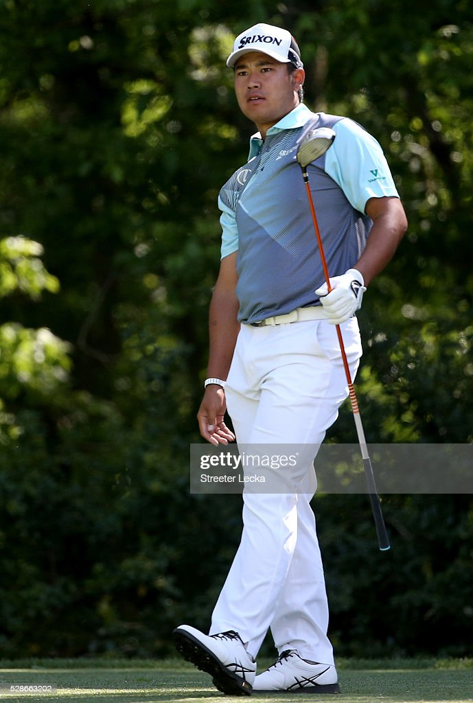 Hideki Matsuyama watches a tee shot on the 12th hole during the second round of the 2016 Wells Fargo Championship at Quail Hollow Club on May 6, 2016 in Charlotte, North Carolina.