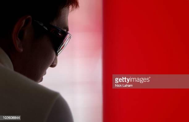 Hideki Mutoh driver of the Formula Dream/Panasonic Dallara Honda in his pit box during qualifying for the IZOD IndyCar Series Camping World Grand...
