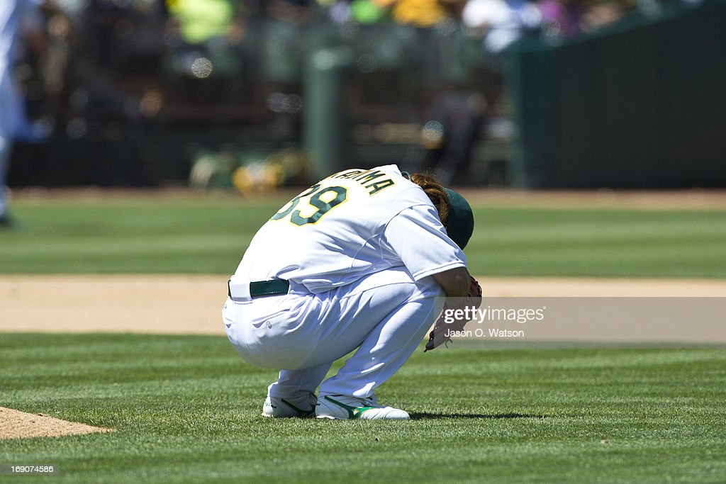 <a gi-track='captionPersonalityLinkClicked' href=/galleries/search?phrase=Hideki+Okajima&family=editorial&specificpeople=4051824 ng-click='$event.stopPropagation()'>Hideki Okajima</a> #39 of the Oakland Athletics kneels behind the pitcher's mound before pitching against the Kansas City Royals during the seventh inning at O.co Coliseum on May 19, 2013 in Oakland, California. The Oakland Athletics defeated the Kansas City Royals 4-3.