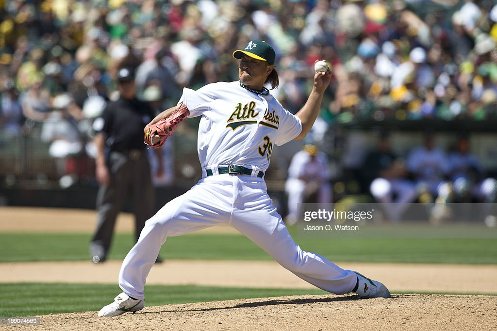 <a gi-track='captionPersonalityLinkClicked' href=/galleries/search?phrase=Hideki+Okajima&family=editorial&specificpeople=4051824 ng-click='$event.stopPropagation()'>Hideki Okajima</a> #39 of the Oakland Athletics pitches against the Kansas City Royals during the seventh inning at O.co Coliseum on May 19, 2013 in Oakland, California. The Oakland Athletics defeated the Kansas City Royals 4-3.