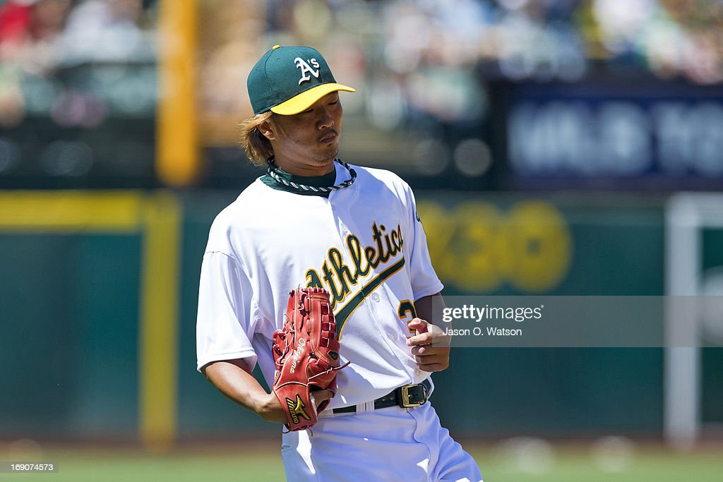 <a gi-track='captionPersonalityLinkClicked' href=/galleries/search?phrase=Hideki+Okajima&family=editorial&specificpeople=4051824 ng-click='$event.stopPropagation()'>Hideki Okajima</a> #39 of the Oakland Athletics returns to the dugout during the middle of the seventh inning against the Kansas City Royals at O.co Coliseum on May 19, 2013 in Oakland, California. The Oakland Athletics defeated the Kansas City Royals 4-3.