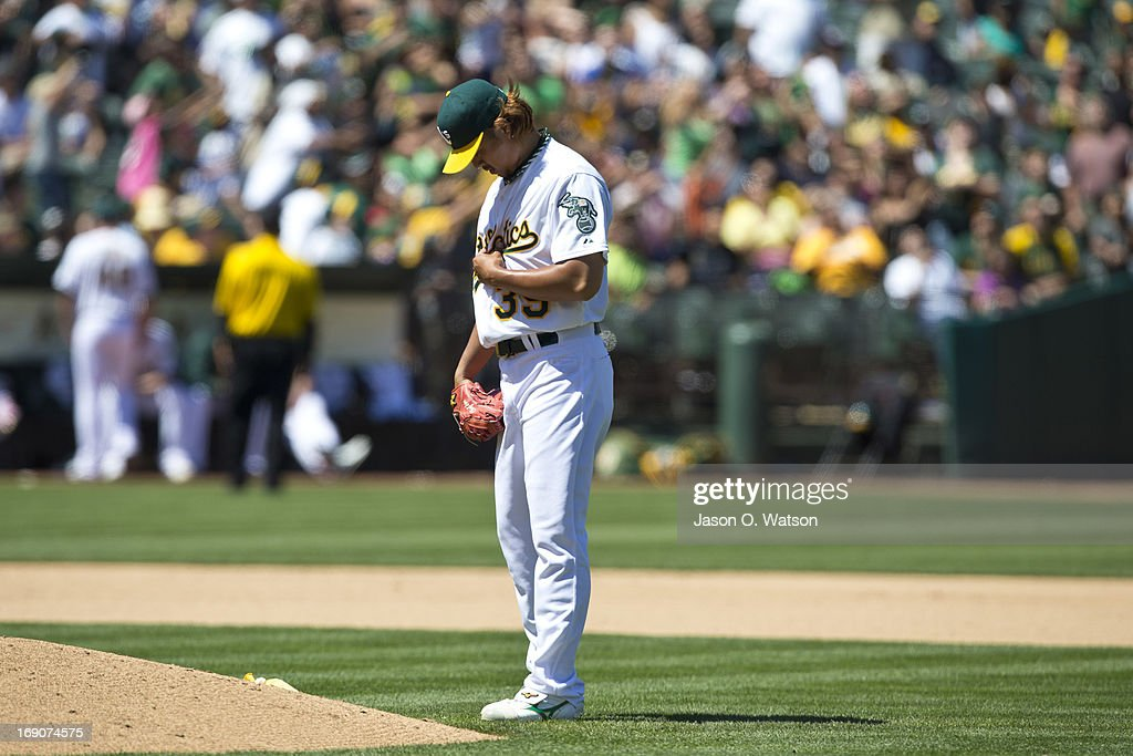 <a gi-track='captionPersonalityLinkClicked' href=/galleries/search?phrase=Hideki+Okajima&family=editorial&specificpeople=4051824 ng-click='$event.stopPropagation()'>Hideki Okajima</a> #39 of the Oakland Athletics stands behind the pitcher's mound before pitching against the Kansas City Royals during the seventh inning at O.co Coliseum on May 19, 2013 in Oakland, California. The Oakland Athletics defeated the Kansas City Royals 4-3.