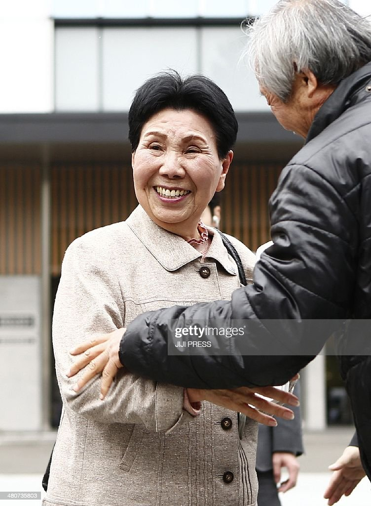 Hideko Hakamada (C), sister of former boxer Iwao Hakamada who has been on death row in Japan for 48 years, celebrates with supporters of Iwao outside the Sizuoka District Court in Shizuoka, western Tokyo on March 27, 2014 after the court granted a retrial of Iwao Hakamada, 78, who was arrested 48 years ago for the alleged grisly murder of his boss and the man's family.