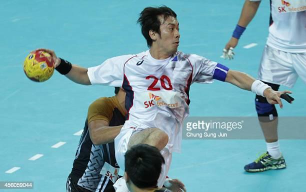 Hidenori Kishigawa of Japan throws the ball during the Handball Men's Group G match between Hong Kong and Japan during the 2014 Asian Games at...