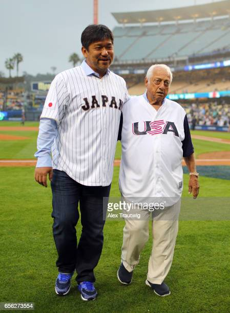 Hideo Nomo and Tommy Lasorda are seen on the field before delivering the ceremonial first pitch prior to Game 2 of the Championship Round of the 2017...