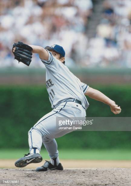 Hideo Nomo of Japan and pitcher for the Milwaukee Brewers winds up to throw a pitch during the Major League Baseball National League Central game...