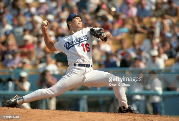 Hideo Nomo of the Los Angeles Dodgers pitches at Dodger Stadium circa 1995 in Los Angeles California