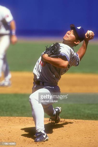 Hideo Nomo of the Los Angeles Dodgers pitches during a baseball game against the New York Mets on May 22 1996 at Shea Stadium in the Flushing...