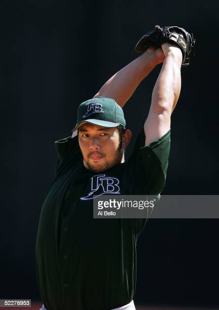 Hideo Nomo of the Tampa Bay Devil Rays pitches between innings against the Cincinnati Reds during their preseason game on March 4 2005 at Ed Smith...