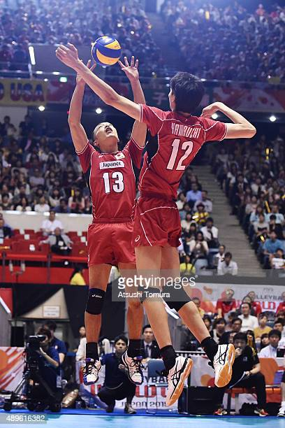 Hideomi Fukatsu of Japan sets up in the match between Japan and Russia during the FIVB Men's Volleyball World Cup Japan 2015 at Yoyogi National...