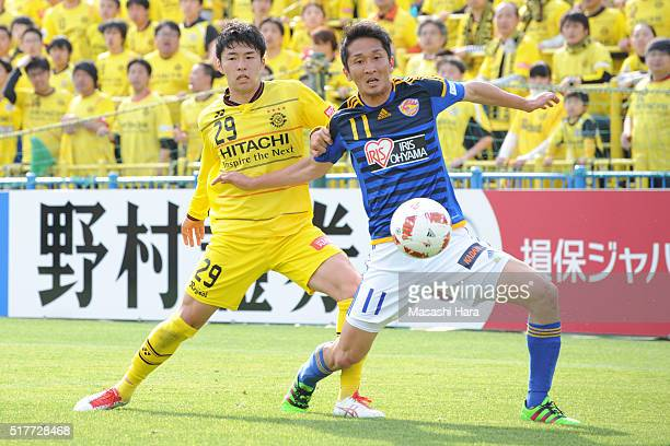Hidetaka Kanazono of Vegalta Sendai and Yuta Nakayama of Kashiwa Reysol compete for the ball during the JLeague Yamazaki Nabisco Cup match between...