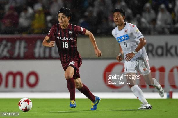 Hideto Takahashi of Vissel Kobe controls the ball under pressure of Ken Tokura of Consadole Sapporo during the JLeague J1 match between Vissel Kobe...