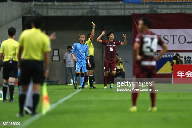 Hideto Takahashi of Vissel Kobe is shown a yellow card by referee Minoru Tojo during the JLeague J1 match between Vissel Kobe and Kawasaki Frontale...
