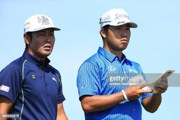 Hideto Tanihara of Japan and Hideki Matsuyama of Japan during a practice round prior to the 2017 US Open at Erin Hills on June 13 2017 in Hartford...