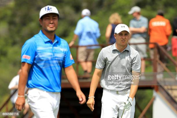 Hideto Tanihara of Japan and Jordan Spieth walk on the 13th hole of their match during round one of the World Golf ChampionshipsDell Technologies...