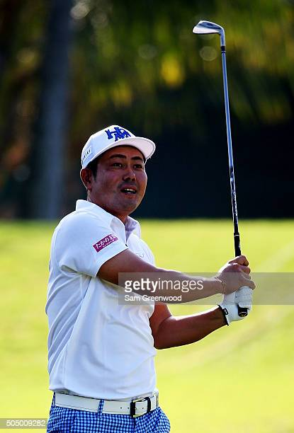 Hideto Tanihara of Japan plays a shot on the 14th hole during the first round of the Sony Open In Hawaii at Waialae Country Club on January 14 2016...