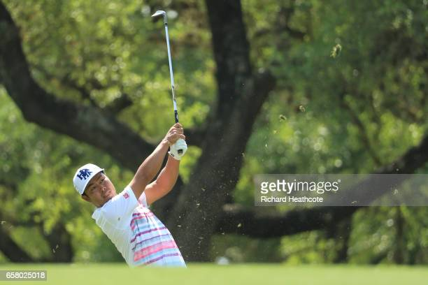 Hideto Tanihara of Japan plays a shot on the 18th hole of his match during the semifinals of the World Golf ChampionshipsDell Technologies Match Play...