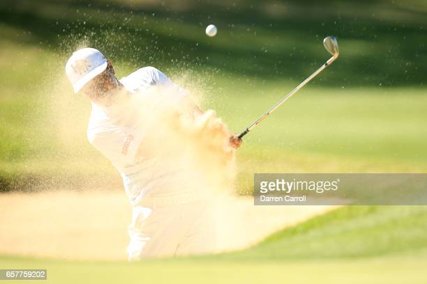 Hideto Tanihara of Japan plays a shot out of a bunker on the 15th hole of his match during round five of the World Golf ChampionshipsDell...
