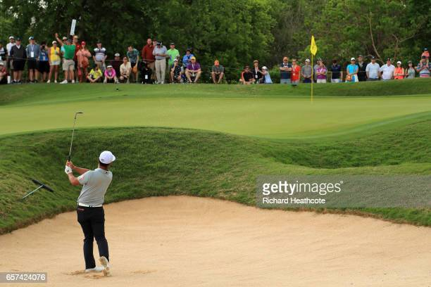 Hideto Tanihara of Japan plays a shot out of a bunker on the 16th hole of his match during round three of the World Golf ChampionshipsDell...