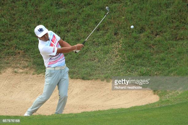 Hideto Tanihara of Japan plays a shot out of a bunker on the 3rd hole of his match during the semifinals of the World Golf ChampionshipsDell...