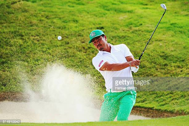 Hideto Tanihara of Japan plays a shot out of the bunker during day three of the 2016 New Zealand Open at The Hills on March 12 2016 in Queenstown New...