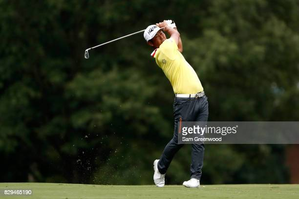 Hideto Tanihara of Japan plays his shot from the 11th tee during the first round of the 2017 PGA Championship at Quail Hollow Club on August 10 2017...