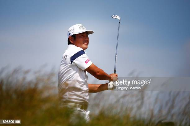 Hideto Tanihara of Japan plays his shot from the sixth tee during the first round of the 2017 US Open at Erin Hills on June 15 2017 in Hartford...