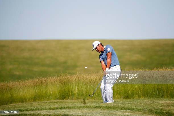 Hideto Tanihara of Japan plays his shot on the 12th hole during the second round of the 2017 US Open at Erin Hills on June 16 2017 in Hartford...