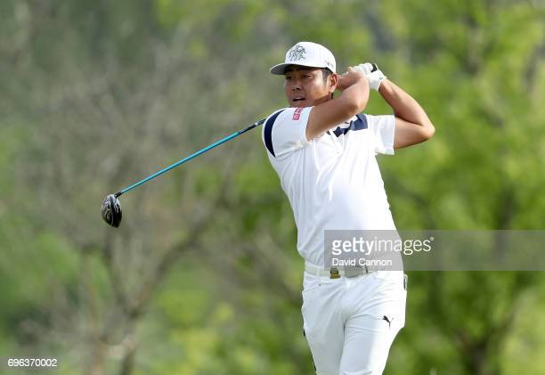 Hideto Tanihara of Japan plays his tee shot on the par 4 10th hole during the first round of the 117th US Open Championship at Erin Hills on June 15...
