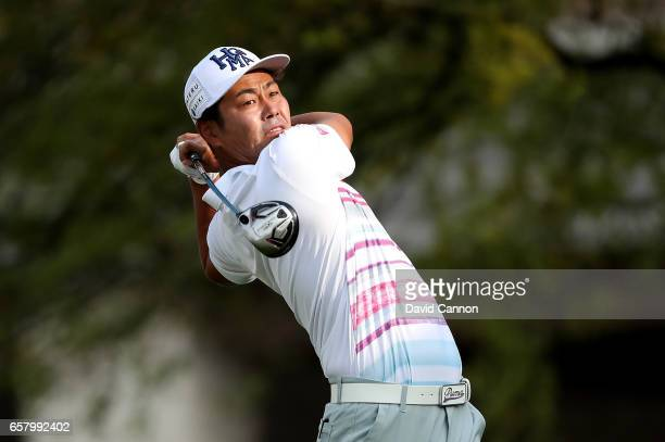 Hideto Tanihara of Japan plays his tee shot on the par 4 first hole in his match against Dustin Johnson during the semifinal of the 2017 Dell Match...