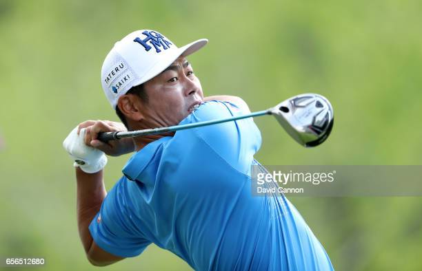 Hideto Tanihara of Japan plays his tee shot on the par 4 third hole in his match against Jordan Spieth of the united States during the first round of...