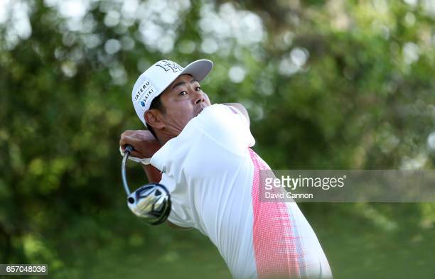 Hideto Tanihara of Japan plays his tee shot on the par 5 12th hole in his match against Ryan Moore during the second round of the 2017 Dell Match...
