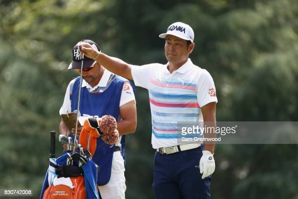 Hideto Tanihara of Japan prepares to play his shot on the third hole during the third round of the 2017 PGA Championship at Quail Hollow Club on...