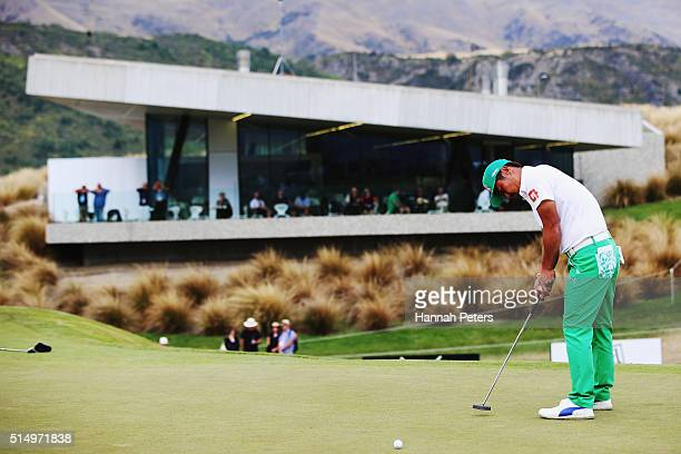 Hideto Tanihara of Japan putts on the eighteenth green to finish in the lead during day three of the 2016 New Zealand Open at The Hills on March 12...