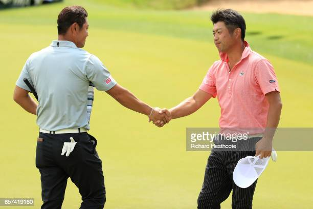 Hideto Tanihara of Japan shakes hands with Yuta Ikeda of Japan after winning their match 31 during round three of the World Golf ChampionshipsDell...