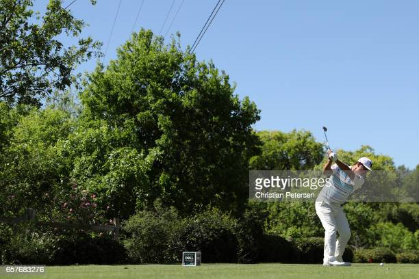 Hideto Tanihara of Japan tees off on the 17th hole of his match during round four of the World Golf ChampionshipsDell Technologies Match Play at the...