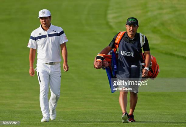 Hideto Tanihara of Japan walks to the tenth green during the first round of the 2017 US Open at Erin Hills on June 15 2017 in Hartford Wisconsin