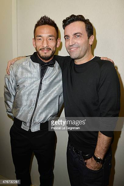 Hidetoshi Nakata and designer Nicolas Ghesquiere pose backstage after the Louis Vuitton show as part of the Paris Fashion Week Womenswear Fall/Winter...