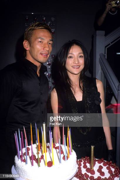 Hidetoshi Nakata and Zhou Xun during Hidetoshi Nakata and Zhou Xun Birthday Party Hosted by the IMG Agency at Restaurant Le Sens in Paris France